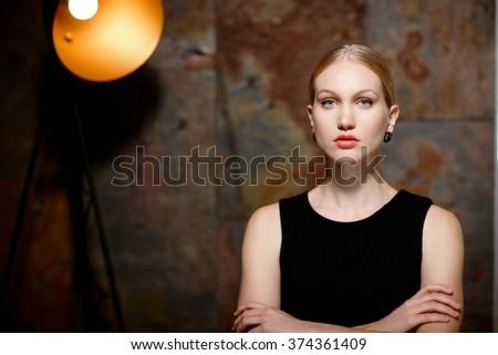 Studio portrait of elegant cold scandinavian woman looking at camera.