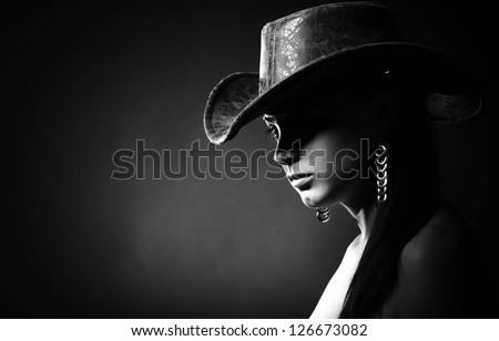 Studio portrait of girl with cowboy hat
