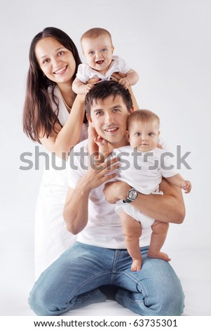 Studio portrait of happy young family with little children