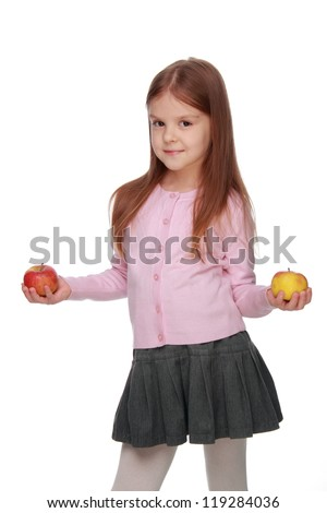 Studio portrait of pretty young ukrainian school girl eating healthy food organic food on Health care theme