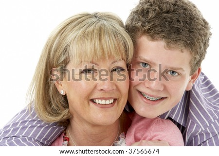 Studio Portrait of Smiling Teenage Boy with Mum