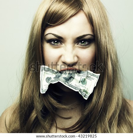 Studio portrait of the young woman eating 100 US dollars