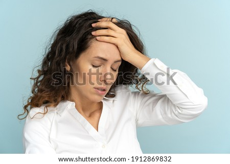 Studio portrait of tired frustrated business woman or office worker touching her forehead, has emotional burnout, exhausted by long work during hot weather in the office, isolated. Mental health. Stock photo ©