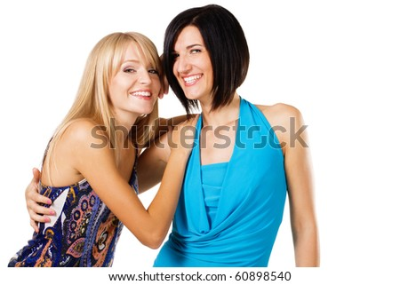 Studio portrait of two young beautiful friends, white background