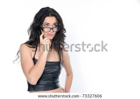 studio portrait of young attractive woman wearing glasses