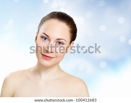 Studio portrait of young beautiful woman natural look