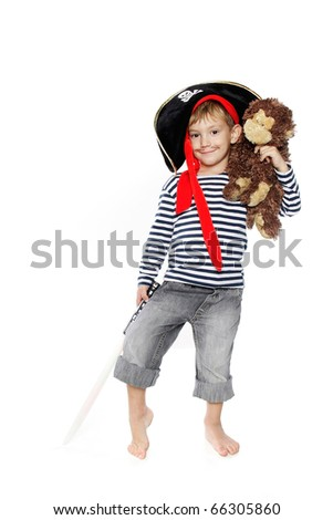 studio portrait of young boy dressed as pirate