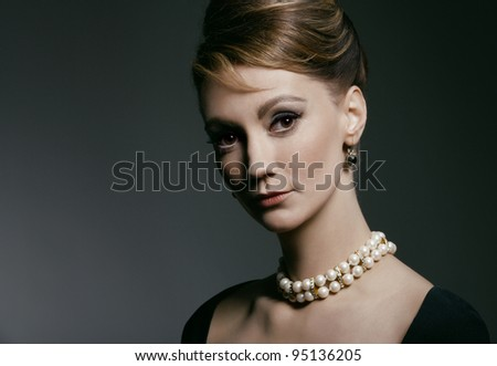 studio portrait of young woman, classic retro styling