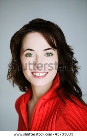 studio portrait on isolated background of a beautiful  caucasian expressive woman
