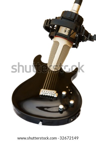 Studio recording microphone with electric guitar on white
