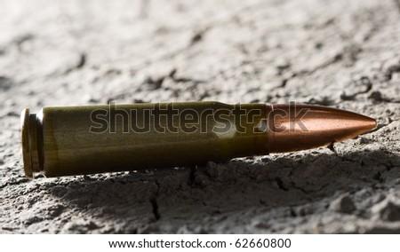 Studio shoot of kalashnikov bullet, backlit technique - stock photo