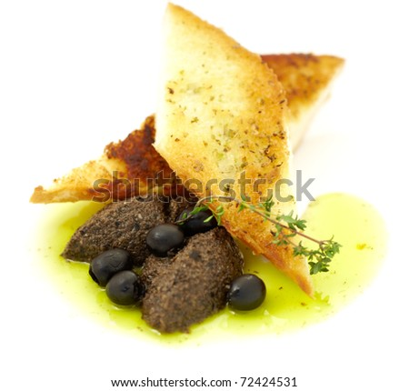 studio shooting of a pate of olives in a toast on white background