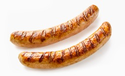 Studio shot close-up of two grilled German sausages on white background for copy space