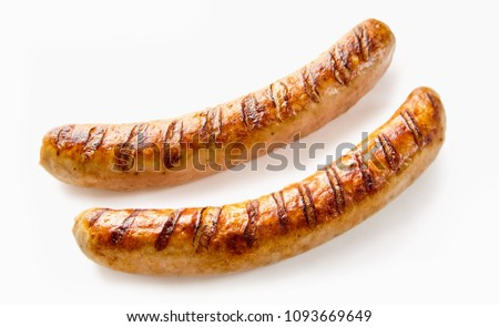 Studio shot close-up of two grilled German sausages on white background for copy space #1093669649