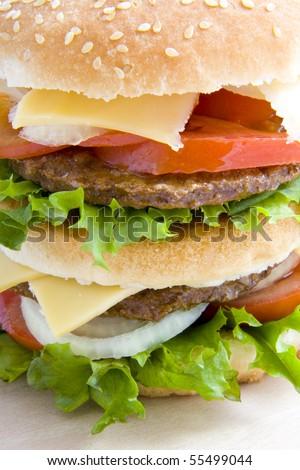 Studio shot from a big tasty hamburger - stock photo