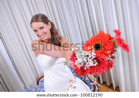 Studio shot of a bride showing us her bouquet