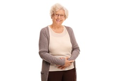 Studio shot of a cheerful old lady smiling and looking at the camera isolated on white background