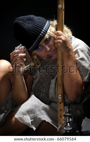 Studio shot of a homeless woman suffering alcoholism