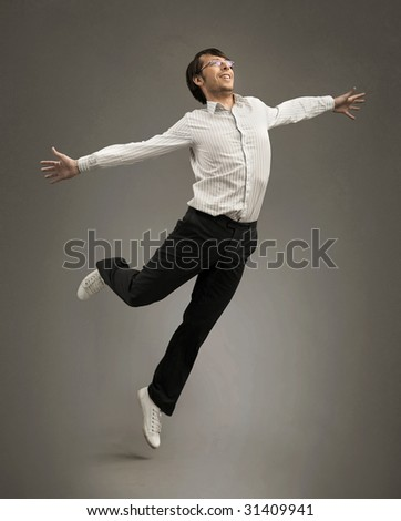 Studio shot of a jumping happy businessman