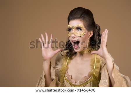 Studio shot of a mysterious party-girl with a mask-covered face