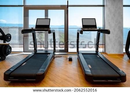 Studio shot of a professional treadmill in modern gym
