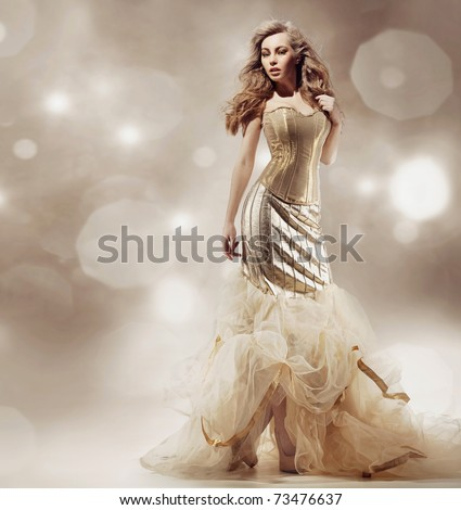 Studio shot of a young beauty wearing luxury dress