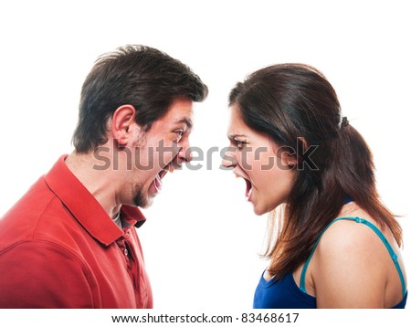 Studio shot of a young couple fighting - stock photo