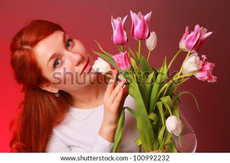 Studio shot of adorable young woman with colorful tulip bouquet/Lovely girl with tulips