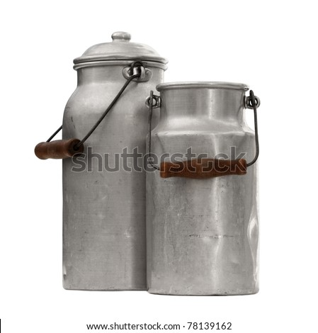 studio shot of an two old and worn out milk can with a handle