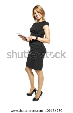 Studio shot of attractive  woman in a black dress. Portrait of office worker isolated on white background.