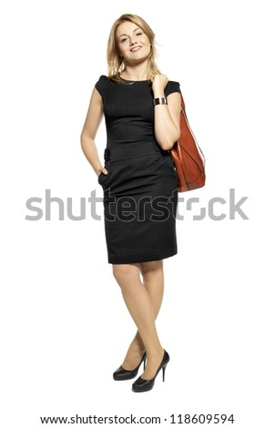Studio shot of attractive  woman in a black dress with a bag. Portrait of businesswoman isolated on white background.