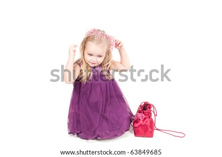 Studio shot of baby girl in gala dress