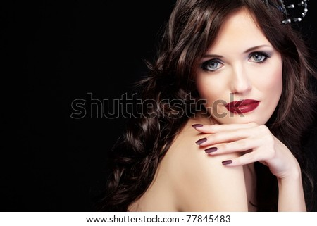 Studio shot of beautiful woman with long hair and red lips - stock photo