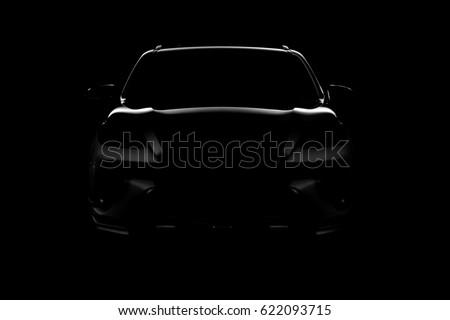 Studio shot of black car isolated on black background