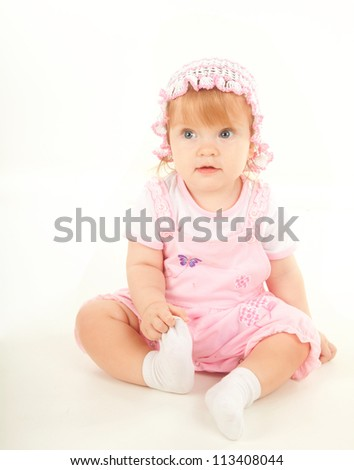 studio  shot of blond little baby girl
