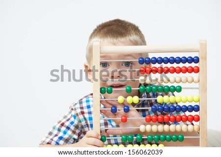 Studio Shot Of Boy Playing With Abacus Stock photo ©