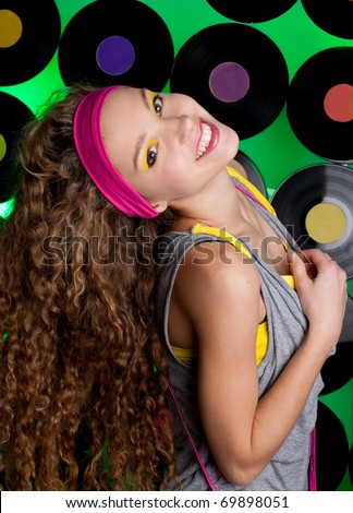 studio shot of cheerful teenage girl on the colorful background