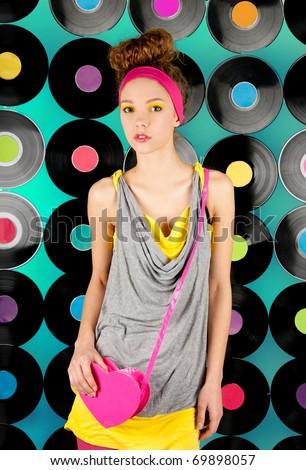 studio shot of cheerful teenage girl on the colorful background