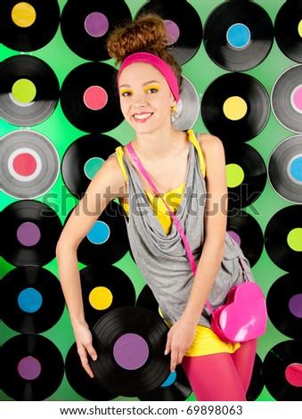 studio shot of cheerful teenage girl over the colorful background