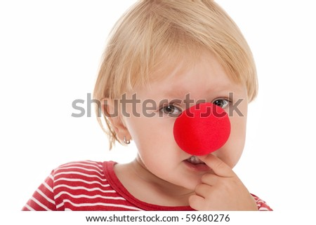 studio shot of child with clown nose