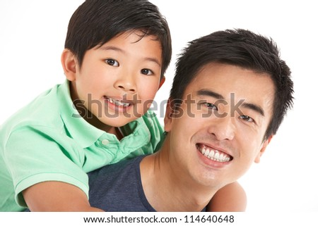 Studio Shot Of Chinese Father And Son