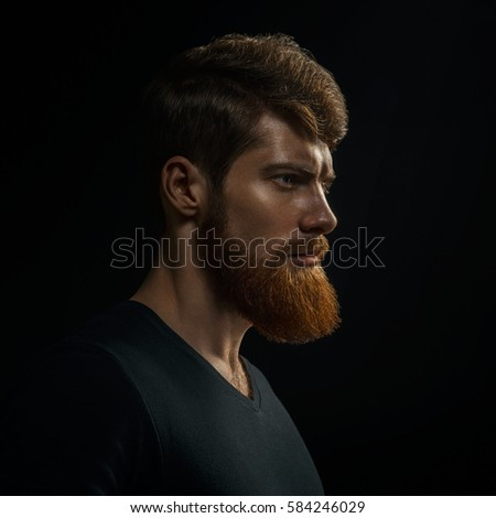 Studio shot of confidence attractive hipster Dramatic light concept Black background Copy space Bearded man #  sc 1 st  Avopix.com & Free Portrait of a serious young man in dramatic lighting. Photos ... azcodes.com