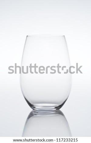 Studio shot of empty vine glass on gradient background specifically suited for Amarone, Barbera, Cornas, Grenache, Malbec, Mourvedre, Shiraz, Syrah, Tannat, Zweigelt, with reflection