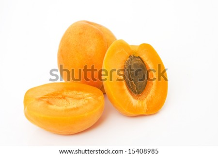 studio shot of fresh apricots isolated against white background