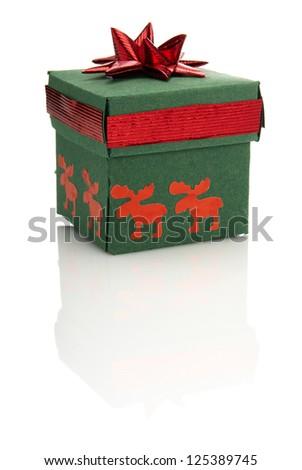 Studio shot of green gift box with red decoration. Zdjęcia stock ©