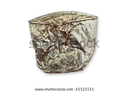 Studio shot of isolated crushed tin can with clipping path on white background