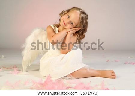Studio shot of little girl as an angel. - stock photo