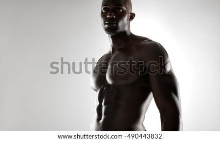 studio shot of muscular man...