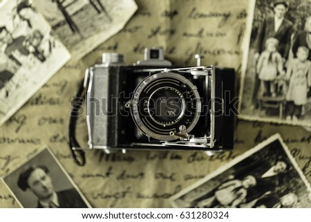 Studio shot of old vintage photo camera with pictures