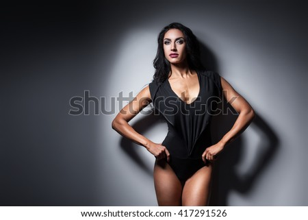 studio shot of perfect body of bodybuilder female; fitness woman with sexy muscular body in sexy wear; #417291526